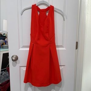 C. Luce red cocktail dress